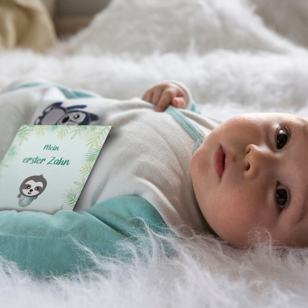 Baby Entwicklung der erste Zahn