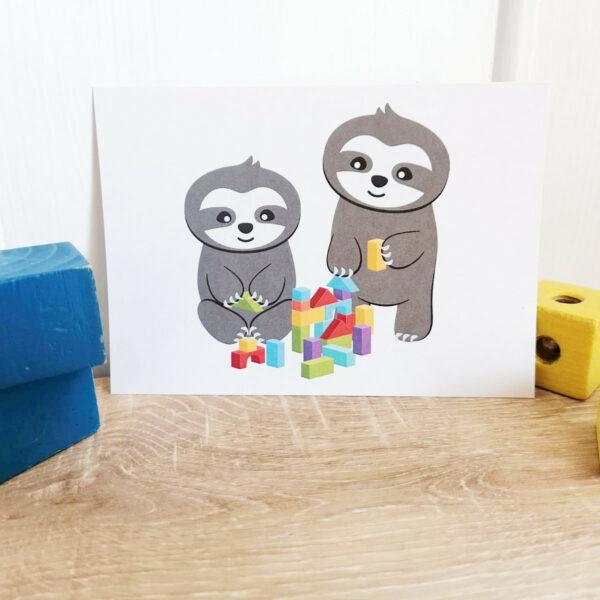 Postkarte_Faultier Grüße für Geschwister